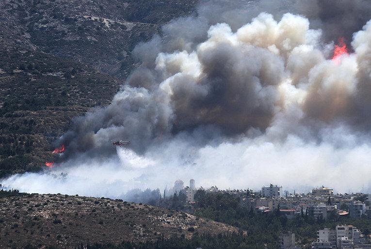 Причиной пожаров в Греции, встревоживших туристов, местные правоохранители считают поджоги